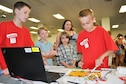 Zain, 11, and Andrew, 10, teach children to use a piano they created using Scratch software, a software program, and a Makey Makey kit, an electronic invention tool that allows users to connect everyday objects to computer programs during the 45th Space Wing's All SySTEMs Go event June 11, 2016, at the Youth Center/Shark Center at Patrick Air Force Base, Fla. Both boys have about 1.5 years in the robotics program at their school, and demonstrated their latest invention at the event, designed to teach children of all ages about science, technology, engineering and math. (U.S. Air Force Photo/Tech. Sgt. Erin Smith/Released)