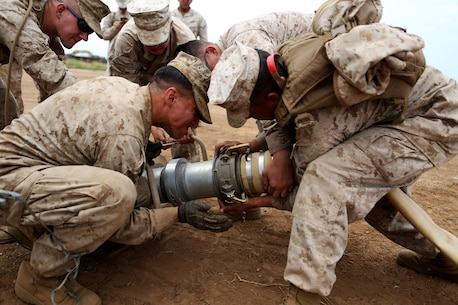 Bulk fuel and water purification Marines from 6th Engineer Support Battalion, 4th Marine Logistics Group, use an extension to make a connection between two four-inch discharge hoses during an annual training exercise aboard Camp Pendleton, Calif., June 13, 2016 to increase readiness and fulfill their yearly requirements as a reserve unit. 7th ESB, 1st Marine Logistics Group, supported their reserve counterparts with the gear necessary to pump water nearly 3 miles from the ocean at Red Beach to a training area where they practiced setting up and maintaining massive stores of water. (U.S. Marine Corps photo by Sgt. Carson Gramley/released)