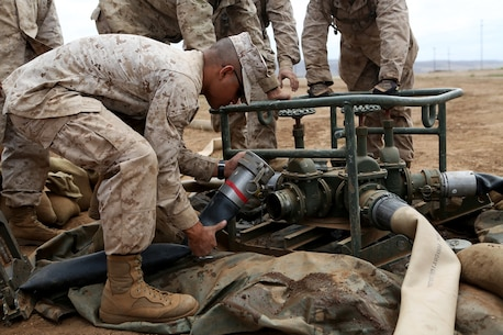 Bulk fuel and water purification Marines from 6th Engineer Support Battalion, 4th Marine Logistics Group, connect hoses to a spider manifold system during an annual training exercise aboard Camp Pendleton, Calif., June 13, 2016 to increase readiness and fulfill their yearly requirements as a reserve unit. 7th ESB, 1st Marine Logistics Group, supported their reserve counterparts with the gear necessary to pump water nearly 3 miles from the ocean at Red Beach to a training area where they practiced setting up and maintaining massive stores of water. (U.S. Marine Corps photo by Sgt. Carson Gramley/released)