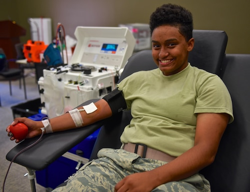 Airman 1st. Class Ashlei Scott, 932nd Security Forces Squadron, smiles for a photo while donating blood with the American Red Cross, June 16, 2016 at the 932nd Airlift Wing building auditorium.  Scott said this was her first time to donate blood and welcomed the opportunity to give back.  Other a small bit of discomfort and was surprised by the size of the needle, Scott said the process was easy and plans to be a regular donor.   (U.S. Air Force photo by Christopher Parr)