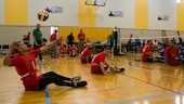 U.S. Marine Corps Lance Cpl. Robert Anfinson serves the ball during a 2016 Department of Defense Warrior Games sitting volleyball match at the U.S. Military Academy at West Point, N.Y., June 13, 2016. Jimenez, a Plymouth, Montana native, is a member of the 2016 DoD Warrior Games Team Marine Corps. The 2016 DoD Warrior Games is an adaptive sports competition for wounded, ill and injured Service members and veterans from the U.S. Army, Marine Corps, Navy, Air Force, Special Operations Command and the British Armed Forces.
