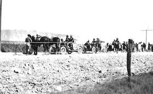 """Kentucky National Guardsmen on patrol on horseback and by automobile along a roadway outside El Paso, Texas, circa 1916. June 18, 2016, is the 100th anniversary of the """"Great Mobilization"""" order of the National Guard to the U.S.-Mexico Border."""