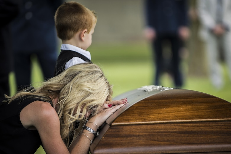"The family of Lt. Col. William ""Bill"" Schroeder, pay their final respects during Schroeder's interment ceremony, June 16, 2016, at Arlington National Cemetery, Virginia. Schroeder, 39, was a special operations weather officer who identified a perilous situation and reacted swiftly by putting himself between an armed individual and his first sergeant. In the process, he saved lives of other squadron members while being fatally wounded. (U.S. Air Force photo by Airman 1st Class Philip Bryant)"