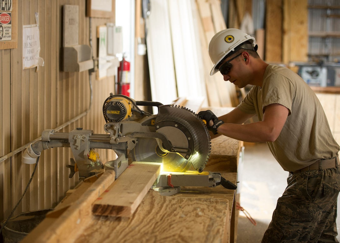 Staff Sgt. John Gibson, 446th Civil Engineer Squadron structures technician, cuts a piece of wood to the proper length for a house under construction in Gallup, NM, June 13, 2016. Rainier Wing Citizen Airmen participated in Operation Footprint, a partnership of the Southwest Indian Foundation and the Department of Defense's Innovative Readiness Training program, which provides an avenue for training military members. The two-week training allowed Citizen Airmen to construct homes, which will be given to tribal members of the Navajo Nation who are in need. (U.S. Air Force Reserve photo by Tech. Sgt. Bryan Hull)