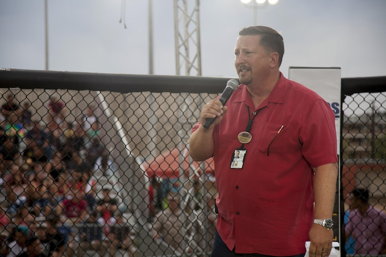 Brent Norquist, deputy assistant chief of staff, Marine Corps Community Services, speaks with the Marines before the bouts begin during the Mixed Marital Arts Fight Night Live at Del Valle Field aboard the Marine Corps Air Ground Combat Center, Twentynine Palms, Calif., June 10, 2016.  (U.S. Marine Corps photo by Lance Cpl. Devin Andrews/Released)