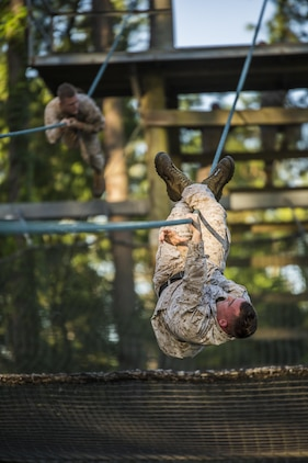Marines slide down a rope obstacle during a confidence course in Marine Corps Recruit Depot Parris Island during a physical training event June 9. The Provost Marshal's Office coordinated the event to challenge the Marines physically, build camaraderie and promote teamwork. Marines from every section of PMO participated in the event. The Marines are with PMO, Marine Corps Air Station Beaufort.