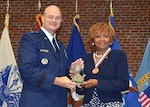 Mary Studevant, Defense Logistics Agency Aviation's 34th Hall of Fame recipient, receives award from DLA Aviation Commander Brig. Gen. Allan Day, during an induction ceremony June 16, 2016 at the Lotts Conference Center on Defense Supply Center Richmond, Virginia.