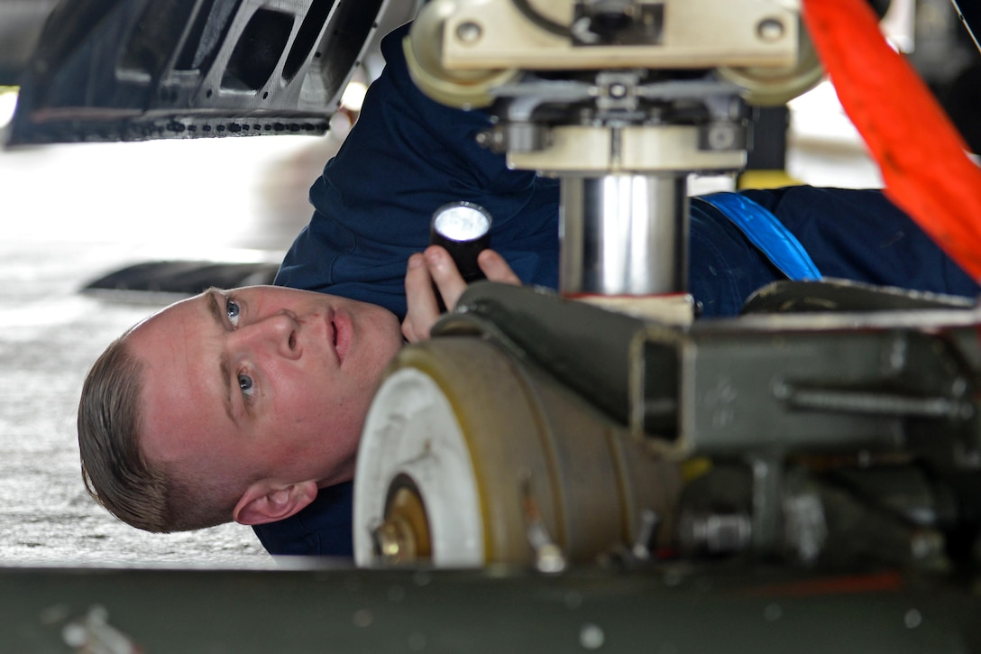 Senior Airman Ryan Turnbull, 9th Aircraft Maintenance Squadron U-2 Dragon Lady dedicated crew chief, performs a post-flight inspection of a U-2's rear landing gear June 7, 2016, at Royal Air Force Fairford, Gloucestershire, England. Turnbull was a member of Beale's en route recovery team (ERT), at RAF Fairford, which transitions aircraft from and to Beale Air Force Base, California, and forward operating locations (FOL). The ERT is used like a pit crew at the midway point in Fairford, ensuring the aircraft are prepared to make it to their next destination. (U.S. Air Force photo by Senior Airman Ramon A. Adelan)