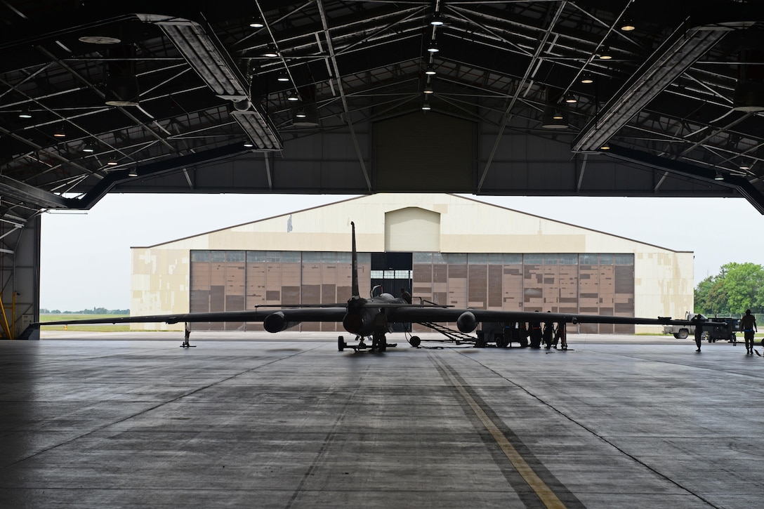 A U-2 Dragon Lady is inspected June 7, 2016, at Royal Air Force Fairford, Gloucestershire, England. The U-2 was met by Beale's en route recovery team (ERT) to perform maintenance before being sent to a forward operating location (FOL). (U.S. Air Force photo by Senior Airman Ramon A. Adelan)