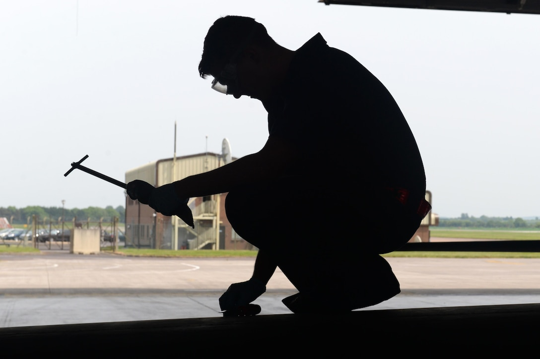 Airman 1st Class Aaron Nymeyer, 9th Aircraft Maintenance Squadron U-2 Dragon Lady dedicated crew chief, checks fuel levels of an aircraft June 7, 2016, at Royal Air Force Fairford, Gloucestershire, England. Nymeyer was a member of Beale's en route recovery team (ERT), at RAF Fairford, which transitions aircraft from and to Beale Air Force Base, California, and forward operating locations (FOL). The ERT is used like a pit crew at the midway point in Fairford, ensuring the aircraft are prepared to make it to their next destination. (U.S. Air Force photo by Senior Airman Ramon A. Adelan)
