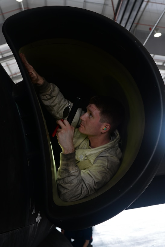 Senior Airman Ryan Raggio, 9th Aircraft Maintenance Squadron aerospace propulsion technician, performs a post-flight inlet inspection June 7, 2016, at Royal Air Force Fairford, Gloucestershire, England. Raggio was a member of Beale's en route recovery team (ERT), at RAF Fairford, which transitions aircraft from and to Beale Air Force Base, California, and forward operating locations (FOL). The ERT is used like a pit crew at the midway point in Fairford, ensuring the aircraft are prepared to make it to their next destination. (U.S. Air Force photo by Senior Airman Ramon A. Adelan)