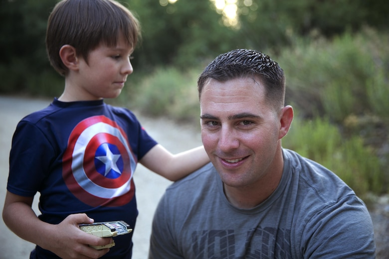 Gunnery Sgt. Ira Heide works hard to balance his duties as a Marine and his obligations as a single parent. He has served as a Marine for 16 years and as a father for seven to his son, Jessen.