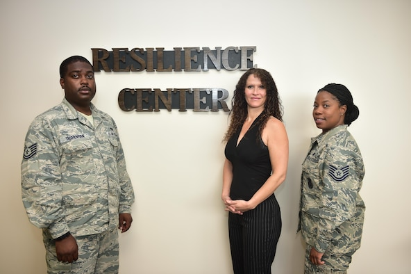 Tech. Sgt. Jameson Thorton, left, master resilience trainer with the Comanndo Ready Resilience Center, April Crooks, center, program administrator with the center and Tech. Sgt. Patisha Johnson, Hurlburt Field Green Dot coordinator pose for a photo on Hurlburt Field, Fla., May 26, 2016. Crooks facilitates the suicide alertness for everyone, Talk, Ask, Listen, Keep safe (safeTALK) course which teaches Airmen how to identify signs of suicide risk and where to seek help. (U.S. Air Force photo by Senior Airman Jeff Parkinson)