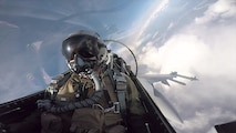 """U.S. Air Force Capt. Todd Possemato, an 18th Aggressor Squadron pilot, flies an F-16 Fighting Falcon fighter aircraft May 12, 2016, as a """"bad guy"""" for a sortie during RED FLAG-Alaska 16-1 at Eielson Air Force Base, Alaska. The average Aggressor pilot has at least 1,000 fighter hours and hundreds of hours of studying to become experts in enemy tactics used to train U.S. Air Force, joint and coalition partners during U.S. Pacific Air Forces commander-directed RF-A exercises. (U.S. Air Force photo/Released)"""