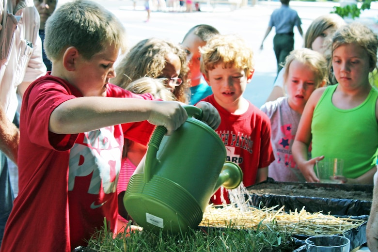 Children learn how different surfaces and vegetation effect runoff and erosion at the Natural Resource Conservation Service's booth during the Get Outdoors Day activities at the U.S. Army Corps of Engineers Nashville District's Lake Cumberland Natural Resource Manager's Office in Somerset, Ky., June 16, 2016.