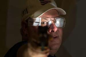Medically retired Navy Petty Officer 1st Class Robert Dodd poses with the air pistol that he'll use during competition at the 2016 Department of Defense Warrior Games at the U.S. Military Academy in West Point, N.Y., June 15, 2016. DoD photo by EJ Hersom