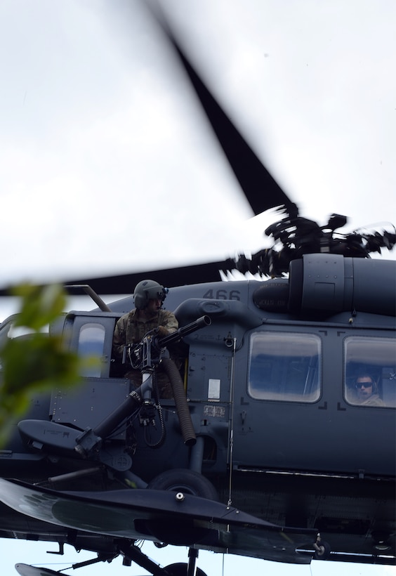 A U.S. Air Force flight engineer gunner assigned to the Alaska Air National Guard's 210th Rescue Squadron (RQS) Detachment (Det) 1 watches for opposing forces as his HH-60G Pave Hawk rescue helicopter approaches a pilot waiting for extraction inside the Joint Pacific Alaska Range Complex as part of a personnel recovery exercise June 14, 2016, during RED FLAG-Alaska (RF-A) 16-2. The 210th RQS Det 1, based at Eielson Air Force Base, Alaska, provides a crucial support role for potential alert incidents during RF-A exercises, which can occur in the more than 67,000 square mile area known as the Joint Pacific Alaska Range Complex. (U.S. Air Force photo by Master Sgt. Karen J. Tomasik)