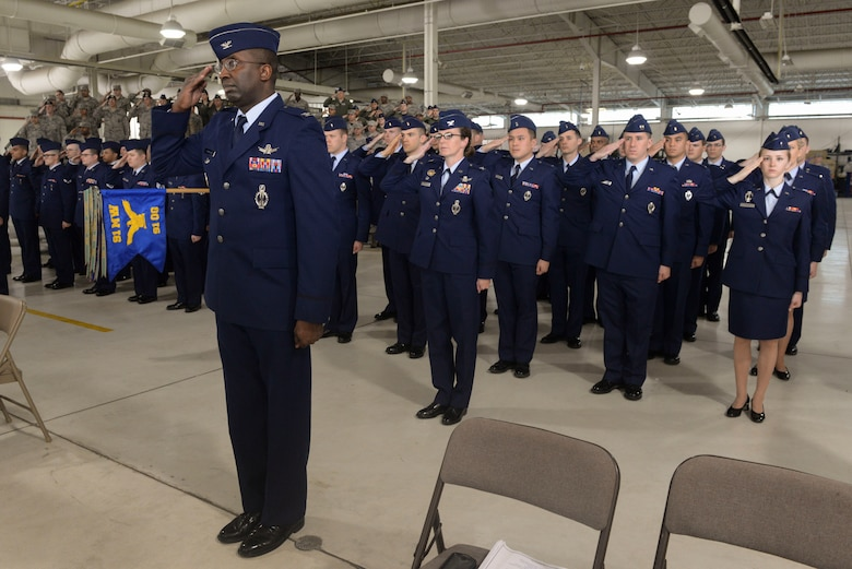 Col. Kelvin Townsend, vice commander of the 91st Missile Wing, and other members of the 91st MW present a first salute to Col. Colin Connor during the 91st MW change of command ceremony June 17, 2016. Connor assumed command of the 91st MW after serving in Washington, D.C., as a Chief of Staff of the Air Force Fellow. (U.S. Air Force photo/Airman 1st Class Jessica Weissman)