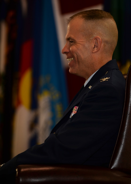 Col. Michael Lutton, previous 91st Missile Wing commander, laughs during his promotion ceremony at Minot Air Force Base, N.D., June 17, 2016. Lutton was selected to be promoted in December 2015. (U.S. Air Force photo/Airman 1st J.T. Armstrong)