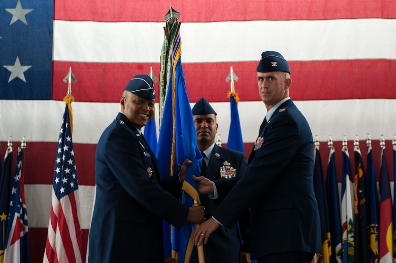 Col. Colin Connor accepts command of the 91st Missile Wing during the 91st MW change of command ceremony at Minot Air Force Base, N.D., June 17, 2016. Connor is the 32nd commander of the 91st MW. (U.S. Air Force photo/Senior Airman Kristoffer Kaubisch)