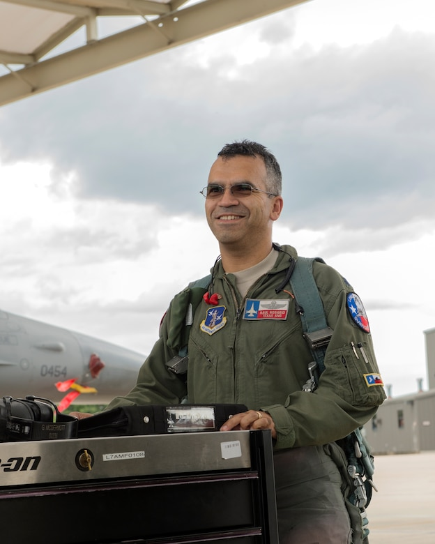 Col. Raul Rosario, newly selected as the 149th Operations Group commander, talks to some members from the 149th Maintenance Group on the flight line after performing routine flying operations June 3, 2016. Rosario is also an F-16 instructor pilot with the 149th Fighter Wing, Texas Air National Guard, at Joint Base San Antonio-Lackland, Texas.