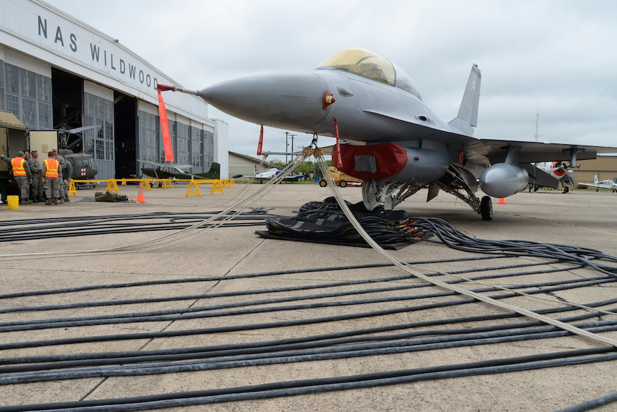 A decommissioned U.S. Air Force F-16D Fighting Falcon sits at the Naval Air Station Wildwood Aviation Museum in Cape May, N.J. on May 22, 2016 in preparation for Crash Damaged Disabled Aircraft Recovery (CDDAR) training being conducted by the New Jersey Air National Guard's 177th Fighter Wing.  A primary objective of the CDDAR program is to return any runways involved in a mishap to operational status as soon as practical and 177th CDDAR team members with unique fields of expertise used compressors, gauged manifolds, hoses and pneumatic bags to simulate lifting the aircraft with a failed landing gear. (U.S. Air National Guard photo by Master Sgt. Andrew J. Moseley/Released)