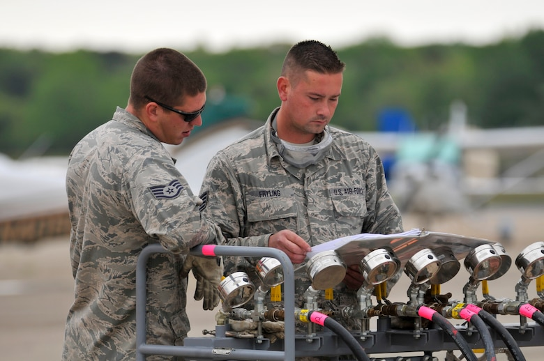 U.S. Air Force Staff Sgts. Edward Fryling, right, and James Dzierwinski review a training guide on manifold pressure operations of a pneumatic a lifting bag assembly during Crash Damaged Disabled Aircraft Recovery (CDDAR) training at the Naval Air Station Wildwood Aviation Museum in Cape May, N.J. May 22, 2016. The members of the New Jersey Air National Guard's 177th Fighter Wing CDDAR team consist of personnel from the engine, electrical-environmental, weapons, hydraulics and egress shops, as well as crew chiefs, selected for the additional duty based on expertise in their field. (U.S. Air National Guard photo by Master Sgt. Andrew J. Moseley/Released)