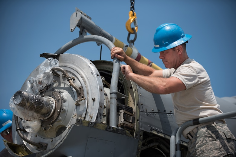 U.S. Air Force Tech. Sgt. Alan Broadus, a propulsion mechanic from the Kentucky Air National Guard's 123rd Airlift Wing, removes an engine from a C-130 Hercules aircraft at the Air National Guard's Air Dominance Center in Savannah, Ga., June 15, 2016. Broadus is attending Maintenance University here, a weeklong course designed to provide intensive instruction in aircraft maintenance. Now in its eighth year, Maintenance University is sponsored by the 123rd Airlift Wing. (U.S. Air National Guard photo by Lt. Col. Dale Greer)