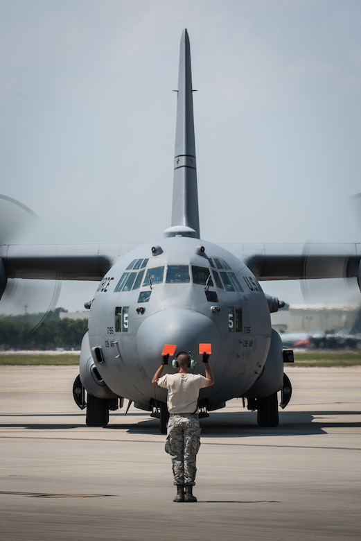 An Airman from the Kentucky Air National Guard's 123rd Airlift Wing marshals a Connecticut Air National Guard C-130 Hercules aircraft at the Air National Guard's Air Dominance Center in Savannah, Ga., June 13, 2016. Airmen from the Connecticut unit are participating in Maintenance University here, a weeklong course designed to provide intensive instruction in aircraft maintenance. Now in its eighth year, Maintenance University is sponsored by the 123rd Airlift Wing. (U.S. Air National Guard photo by Lt. Col. Dale Greer)