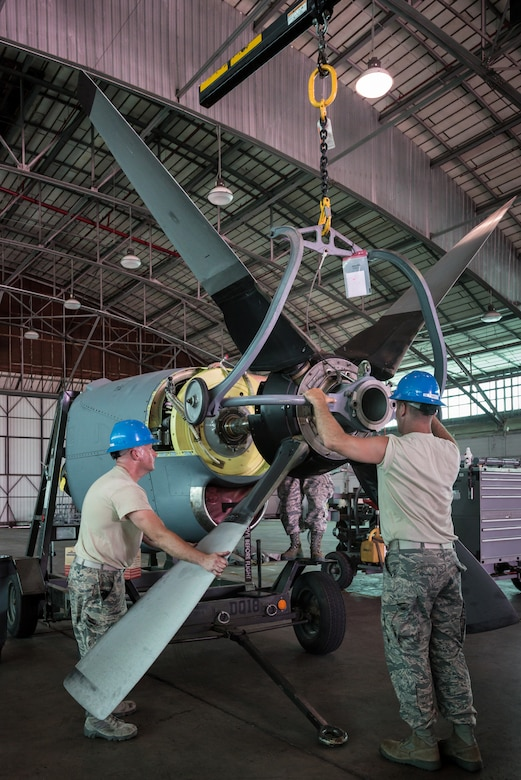 U.S. Air Force Staff Sgt. Michael Marks (left) and U.S. Air Force Tech. Sgt. Alan Broadus, propulsion mechanics from the Kentucky Air National Guard's 123rd Airlift Wing, mount a propeller to a C-130 engine at the Air National Guard's Air Dominance Center in Savannah, Ga., June 15, 2016. Both Airmen are attending Maintenance University here, a weeklong course designed to provide intensive instruction in aircraft maintenance. Now in its eighth year, Maintenance University is sponsored by the 123rd Airlift Wing. (U.S. Air National Guard photo by Lt. Col. Dale Greer)