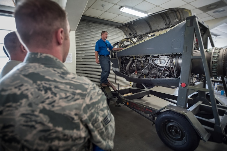 Roger Snow, a field service representative for Rolls-Royce Corp., teaches Airmen from the Connecticut, Kentucky, Montana and Missouri Air National Guard about the operation of C-130 engines during a class at the Air National Guard's Air Dominance Center in Savannah, Ga., June 15, 2016. The class is part of Maintenance University here, a weeklong course designed to provide intensive instruction in aircraft maintenance. Now in its eighth year, Maintenance University is sponsored by the 123rd Airlift Wing. (U.S. Air National Guard photo by Lt. Col. Dale Greer)