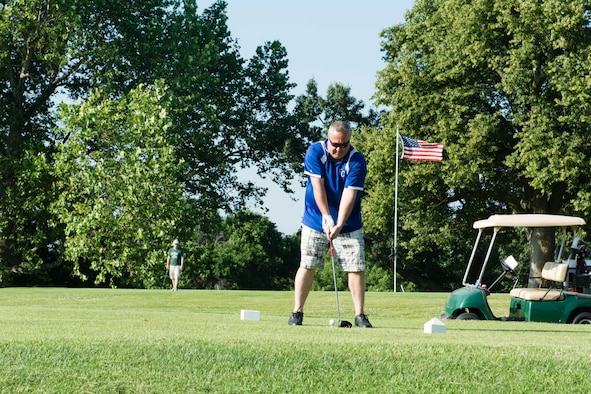 Airmen from the 139th Airlift Wing, Missouri Air National Guard, tee off in the Chiefs Association's annual golf tournament June 17, 2016 in St. Joseph, Mo. Money raised for the tournament goes to local charities and the Airman and Family Readiness Program. (U.S. Air National Guard photo by Tech. Sgt. Michael Crane/released)