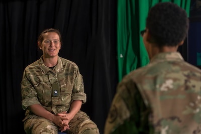 Maj. Hannah Frost of the British army speaks June 16, 2016, about her team's experiences at Cyber Guard 2016, a nine-day exercise that involved some 800 participants in Suffolk, Va., and remote locations. Navy photo by Petty Officer 2nd Class Jesse Hyatt