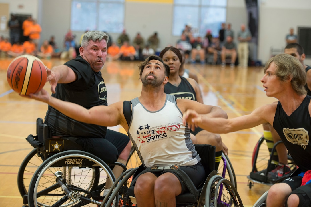Army veterans Chris Parks, left, and Terry Cartwright, block veteran Howard Sanborn, center, representing Southern Command in wheelchair basketball at the 2016 Department of Defense Warrior Games at the U.S. Military Academy in West Point, N.Y., June 18, 2016. DoD photo by Roger Wollenberg