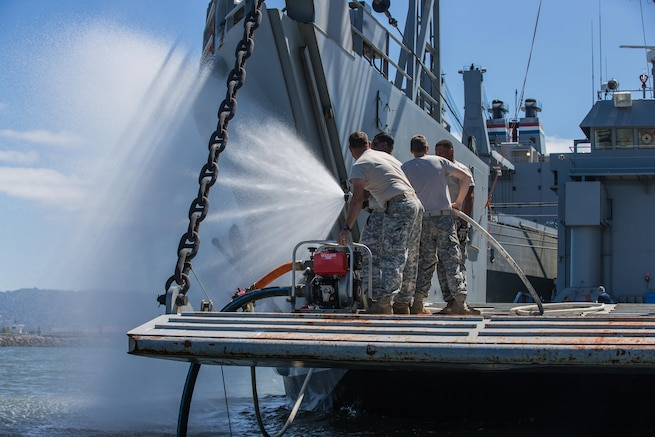 U.S. Army Reserve Soldiers with the 481st Transportation Company, test a fire hose on landing craft utility 2000 USAV Palo Alto during training at the Big Logistics Over The Shore, West exercises at Alameda, Calif., Aug. 3, 2015. Big Logistics Over-The-Shore, West is an annual, Army Reserve, functional exercise designed for transportation units and sustainment commands to hone their expertise in Logistics Over-the-Shore operations from July 25 to Aug. 7, 2015. More than 750 Soldiers are participating this year. The exercise has grown into a multi-component exercise involving elements from the Active Component Army, U.S. Navy, U.S. Air Force, U.S. Coast Guard, and U.S. Maritime Administration are conducting operations at three Bay-Area California training locations: Camp Parks, Alameda Point, and Military Ocean Terminal-Concord (MOTCO).