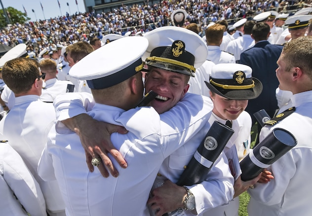 Newly commissioned ensigns cheer and congratulate one another after graduating from the U.S. Merchant Marine Academy in Kings Point, New York, June 18. The 2016 graduating class included 229 senior midshipmen, each earning a Bachelor of Science degree, a direct commission into the armed forces and a U.S. Coast Guard license. (U.S. Army photo by Master Sgt. Michel Sauret)
