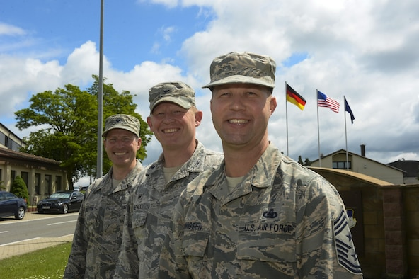 U.S. Air Force Chief Master Sgt. Edwin Ludwigsen, 52nd Fighter Wing command chief, right, poses next to U.S. Air Force Col. Joe McFall, 52nd FW commander, center, and U.S. Air Force Col. Steven Horton, 52nd FW vice commander, left, outside of wing headquarters in Spangdahlem Air Base, Germany, June 2, 2016. Ludwigsen assumed the command chief position May 22, 2016, from outgoing command chief, U.S. Air Force Chief Master Sgt. Brian Gates. (U.S. Air Force photo by Staff Sgt. Joe W. McFadden/Released)