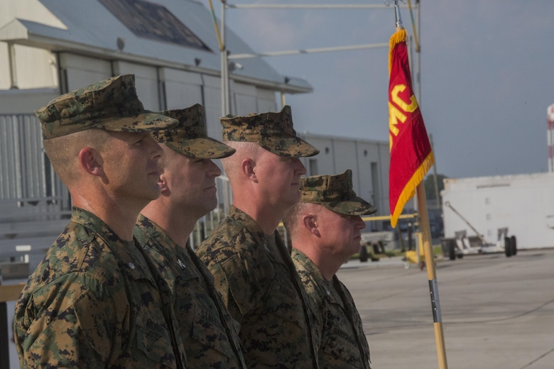Lieutenant colonel David B. Moore, (left), the commanding officer of Marine Light Attack Helicopter Squadron 467, stands alongside past commanding officers of the squadron during its deactivation ceremony at Marine Corps Air Station New River, N.C., June 16, 2016. The squadron served in numerous theaters to include supporting unit deployment programs in Japan, attaching to Marine Expeditionary Units, and providing security to ground troops during Operation Enduring Freedom in Afghanistan.