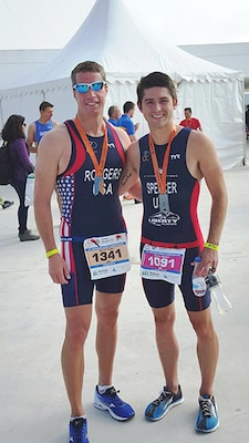 Don Rodgers, left, Defense Logistics Agency Installation Support at Richmond, Virginia's fire chief, poses with Parker Spencer, a Richmond resident and director of Coach Operations, Endorpin Fitness, after competing June 5 in the International Triathlon Union's Duathlon World Championship held in Avilȇs, Spain June 4 – 6, 2016.