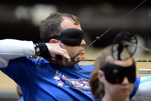 Air Force veteran Master Sgt. D. Reese Hines competes in archery for visually impaired people during the 2016 Department of Defense Warrior Games at the U.S. Military Academy in West Point, N.Y. June 17, 2016. DoD photo by EJ Hersom
