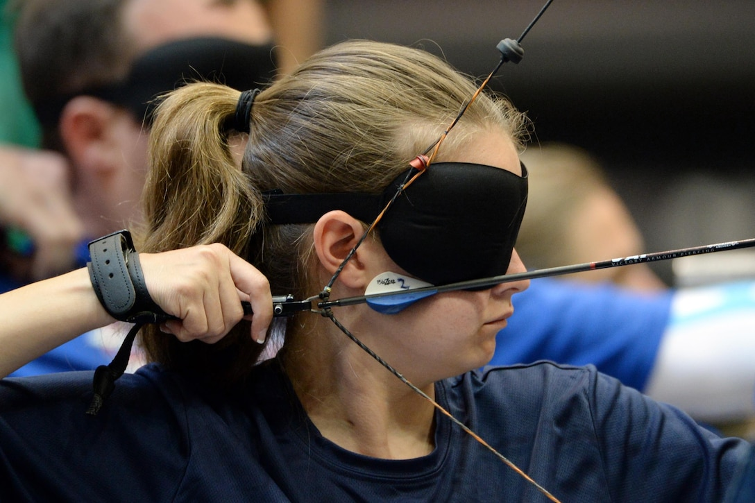 Navy veteran Brittany Jordan competes in the visually impaired archery division of the 2016 Department of Defense Warrior Games at the U.S. Military Academy in West Point, N.Y. June 17, 2016. DoD photo by EJ Hersom