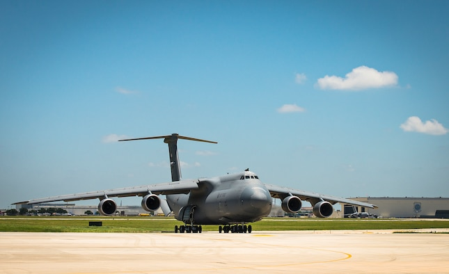 "The 433rd Airlift Wing receives its first C-5M Super Galaxy aircraft, bestowed ""The City of San Antonio,"" during a  transfer ceremony June 17, 2016 at Joint Base San Antonio-Lackland, Texas. Maj. Gen. John C. Flournoy Jr., 4th Air Force commander, and Col. Thomas K. Smith Jr., 433rd AW commander, piloted the maiden flight of the first C-5M from Stewart National Guard Base, New York, that morning. The 433rd AW will receive nine C-5M models by late 2018, which is the result of a two-phase modernization effort that will improve fuel savings, climb rate, payload capability, and noise reduction. (U.S. Air Force photo by Benjamin Faske)"