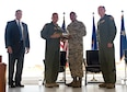"Maj. Gen. John C. Flournoy Jr., 4th Air Force commander, presents Tech. Sgt. David Ponce, 433rd Aircraft Maintenance Squadron crew chief, with the ceremonial key to the first C-5M Super Galaxy aircraft, bestowed ""The City of San Antonio"" June 17, 2016 at Joint Base San Antonio-Lackland, Texas. The 433rd AW will receive nine C-5M models which is the result of a two-phase modernization effort that will improve fuel savings, climb rate, payload capability, and noise reduction. (U.S. Air Force photo by Benjamin Faske)"