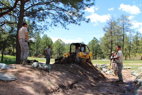 "932nd Civil Engineering Squadron Airmen worked moving dirt and reworking landscaping recently at a remote Air Force Academy site, known as the Field Engineering and Readiness Laboratory (FERL), completing projects that provide students with a solid foundation for learning scientific theory and engineering design principles in more advanced courses of the civil and environmental engineering curriculum. The ""construct first"" approach is the primary focus of Civil Engineering 351 (CivEngr 351), the entry-level course for cadets majoring in Civil and Environmental Engineering at the U.S. Air Force Academy. How is the course run? CivEngr 351 is an integrated, two-phase program over a five-week period. The first phase is Operation Civil Engineering Air Force (OPS CEAF). Students spend two weeks at an operational Air Force base in order to gain an appreciation of Air Force missions, support functions, and civil engineering capabilities. The second phase is FERL. During this three-week phase, students ""deploy"" to the FERL training area to perform hands-on activities in surveying, construction methods, and construction materials under the supervision and guidance of mentors. The 932nd Civil Engineering Squadron interacted with some students at the beginning of their tour who will gain more experience working and living under field conditions as they utilize some of the readiness assets used in the Operational Air Force. (U.S. Air Force photos by Maj. Stan Paregien)"
