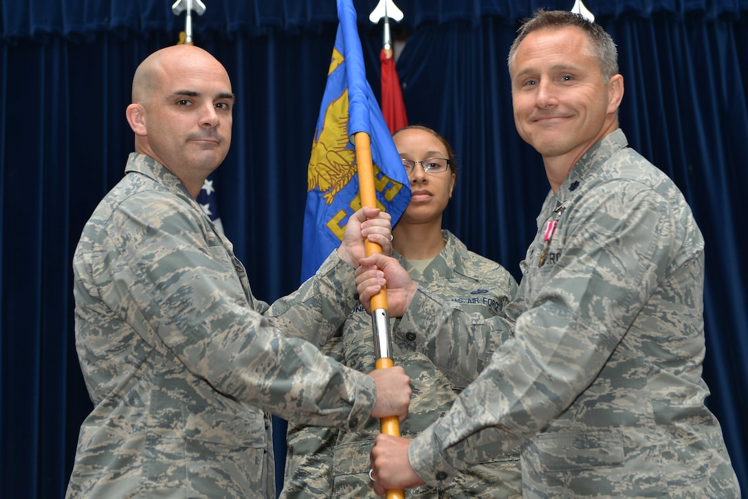 U.S. Air Force Lt. Col. Hardy Giles, 39th Force Support Squadron outgoing commander, relinquishes command to U.S. Air Force Col. Russell Voce, 39th Mission Support Group commander, during a change of command ceremony June 20, 2016, at Incirlik Air Base, Turkey. The 39th FSS provides a wide range of organizational, professional and community support to the organizations and people who live or work at Incirlik Air Base. (U.S. Air Force photo by Senior Airman John Nieves Camacho/Released)