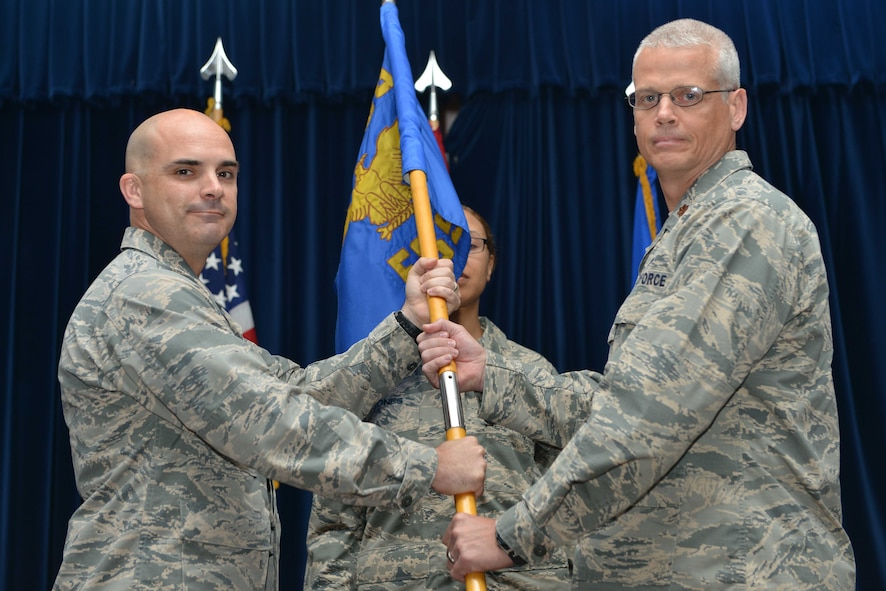 U.S. Air Force Maj. Kenneth Raszinski, 39th Force Support Squadron incoming commander, receives command from U.S. Air Force Col. Russell Voce, 39th Mission Support Group commander, during a change of command ceremony June 20, 2016, at Incirlik Air Base, Turkey. Prior to taking command, Raszinski was the 8th FSS operations officer at Kunsan Air Base, Republic of Korea. (U.S. Air Force photo by Senior Airman John Nieves Camacho/Released)