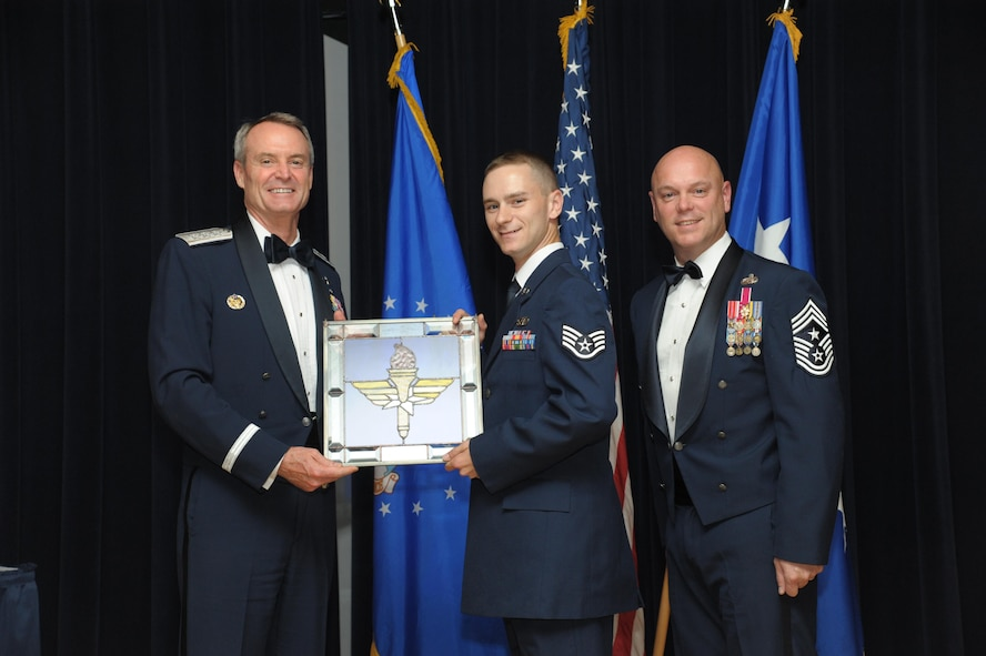 Staff Sgt. Cody Sparks, 47th Communications Squadron, Laughlin Air Force Base, Texas, receives an award from Lt. Gen. Darryl Roberson, commander, Air Education and Training Command and AETC Command Chief Master Sgt. David Staton during a ceremony here, June 16. Sparks was selected as the AETC Airman of the Year. (U.S. Air Force photo by Joel Martinez)