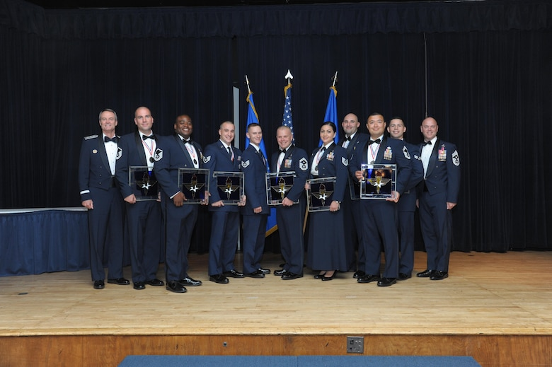 Lt. Gen. Darryl Roberson, commander, Air Education and Training Command and AETC Command Chief Master Sgt. David Staton pose for a photo with the AETC Outstanding Airmen of the Year at a ceremony here, June 16. The award distinguishes AETC's enlisted Airmen for their leadership, job performance, community involvement and personal achievements. (U.S. Air Force photo by Joel Martinez)