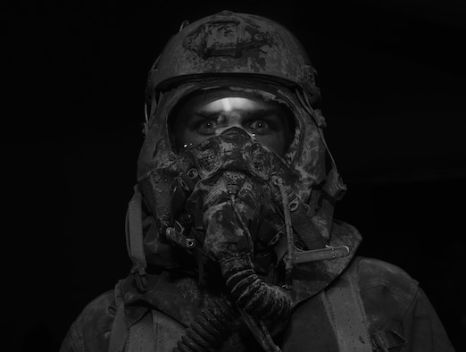 An aircrew member goes through a simulated decontamination line at Hurlburt Field, Fla., June 9, 2016. Air Force Special Operations Command's operations directorate ran a realistic, scenario-based, training program for 16 Airmen from eight southern United States bases. (U.S. Air Force photo/Staff Sgt. Melanie Holochwost)