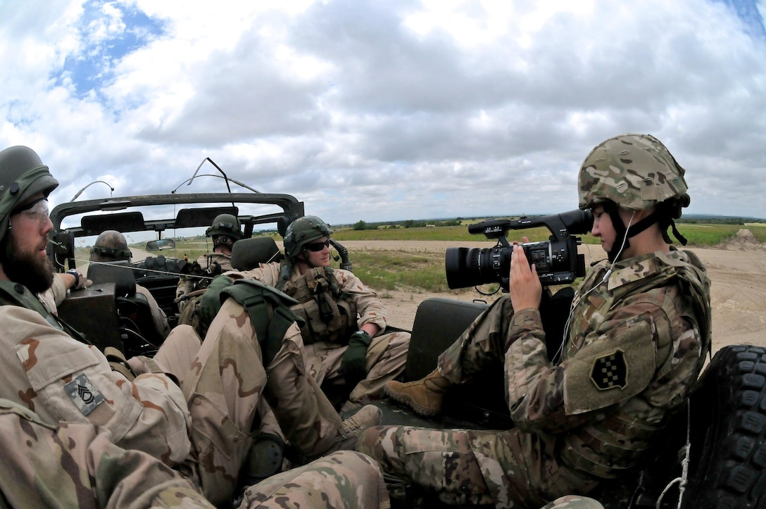FORT HOOD, Texas – Sgt. Jessica Forester, a broadcast operations specialist with the 204th Public Affairs Detachment, records video footage of Dutch Soldiers assigned to the 302nd Dutch Aviation Squadron during multi-faceted training operations May 17 at Fort Hood, Texas. Three U.S. Army journalists assigned to the 204th PAD from Orlando, Fla., embedded with a company of Dutch Soldiers to cover training missions while simulating actual media embeds. (U.S. Army photo by Sgt. Aaron Ellerman, 204th Public Affairs Detachment, 99th RSC)